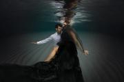 couple-engaged-underwater-photoshoot-black-dress