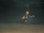 Girl-with-flower-bathing-cap-underwater-portrait-photography-gold-coast